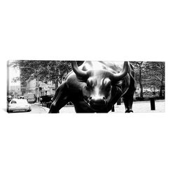 Political 'Wall Street Bull Close-up Panoramic' Photographic Print on Canvas