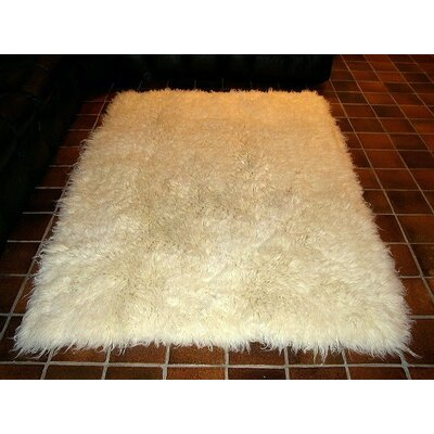 Hera Flokati Extra Natural White Solid Area Rug Rug Size: Rectangle 5 x 7