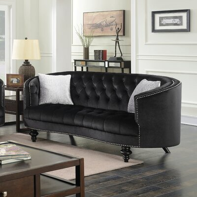 Treshon Chesterfield Loveseat Upholstery: Black