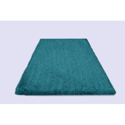 Milan Turquoise Area Rug Rug Size: 79 x 99