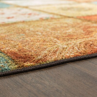 Kenyatta Panel Orange Area Rug