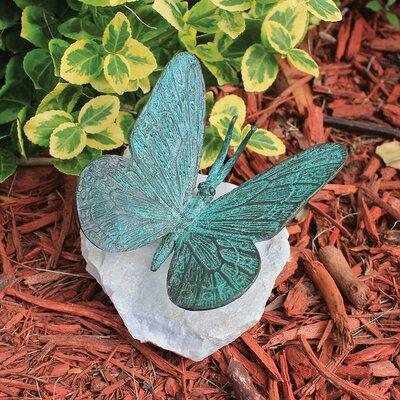 Emerald Verde Butterfly on Rock Statue