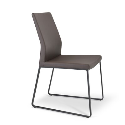 Pasha Slide Upholstered Dining Chair Color: Leatherette Brown