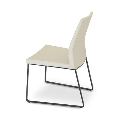 Pasha Slide Upholstered Dining Chair Color: Leatherette Cream