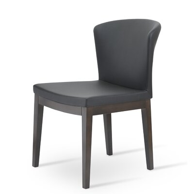 Capri Upholstered Dining Chair Upholstery Color: Black, Frame Color: Walnut