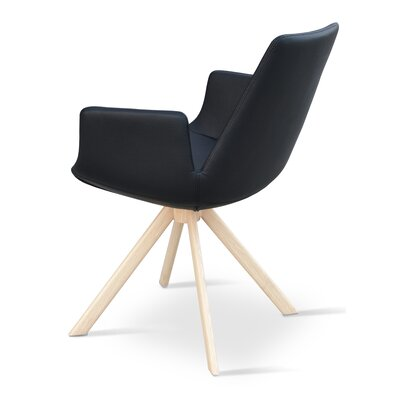 Eiffel Upholstered Dining Chair Upholstery Color: Leatherette Black, Leg Color: Natural