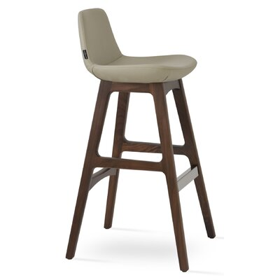 Pera 24 Bar Stool Leg Color: Beech Wood Walnut, Upholstery: Camira Wool-Smoke Blue