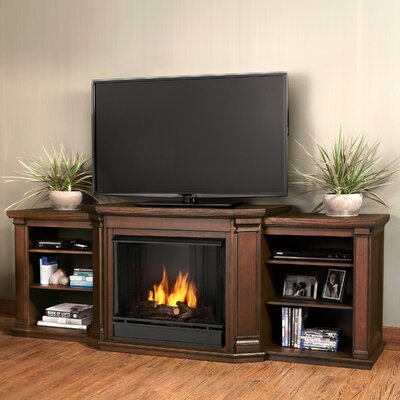 Valmont 75.5 TV Stand with Gel Fuel Fireplace Finish: Chestnut Oak