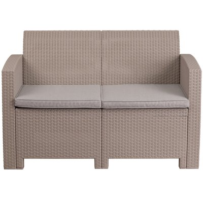 Stockwell Faux Rattan Loveseat with Cushions