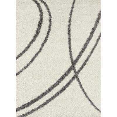 Caressa Line Cream Area Rug Rug Size: 5'3