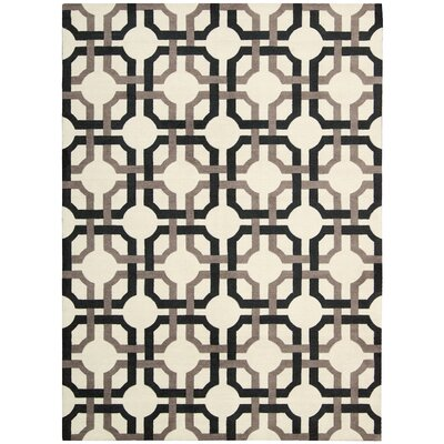 Artisanal Delight Groovy Grille Licorice Area Rug Rug Size: Rectangle 26 x 4