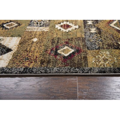 Phillip Gold Area Rug Rug Size: 52 x 73