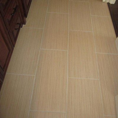 Strands 12 x 6 Porcelain Cove Base Tile Trim in Biscuit