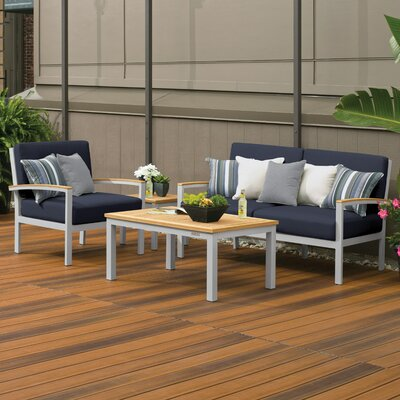 Travira 4 Piece Deep Seating Group with Cushion Fabric: Midnight Blue, Finish: Natural Tekwood