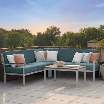 Travira 4 Piece Deep Seating Group with Cushion Finish: Vintage Tekwood, Fabric: Ice Blue