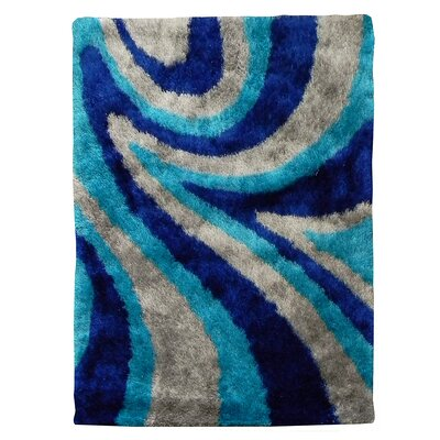 Flash Shaggy Blue Abstract Wave Area Rug Rug Size: 5 x 7