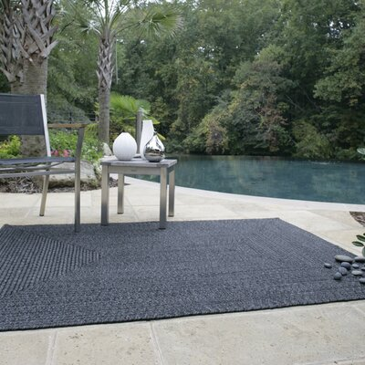 Ultra-Durable Black Indoor/Outdoor Rug Rug Size: Oval 1'8 x 2'6