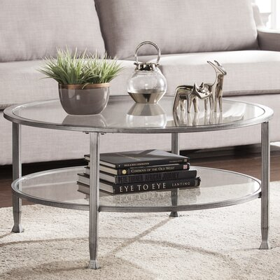 Casas Metal and Glass Round Coffee Table Color: Silver