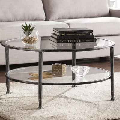 Casas Metal and Glass Round Coffee Table Finish: Black