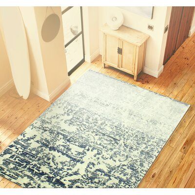 Arlingham Ivory/Blue Area Rug Rug Size: Rectangle 76 x 96