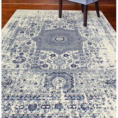Arlingham Ivory/Blue Area Rug Rug Size: 86 x 116
