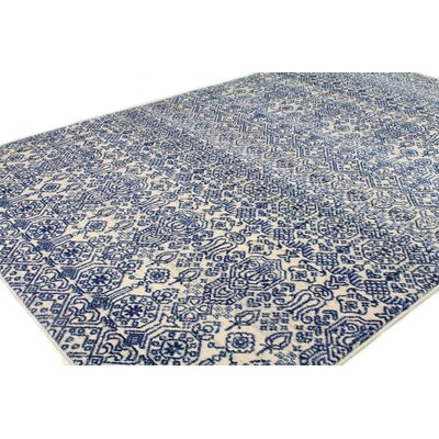 Fiora Ivory/Blue Area Rug Rug Size: Rectangle 76 x 96