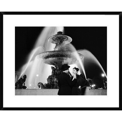 Man and Woman Near Fountain, Paris 1951 by Genevieve Naylor Framed Photographic Print Size: 24