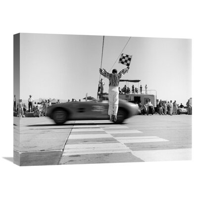 'Man Jumping Waving Checkered Flag' by H. Armstrong Roberts Photographic Print on Wrapped Canvas GCS-463528-1824-142