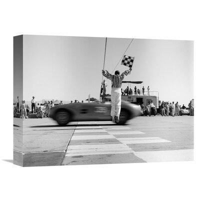'Man Jumping Waving Checkered Flag' by H. Armstrong Roberts Photographic Print on Wrapped Canvas GCS-463528-1216-142