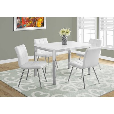 Daisi Metal Dining Table Top Finish: White