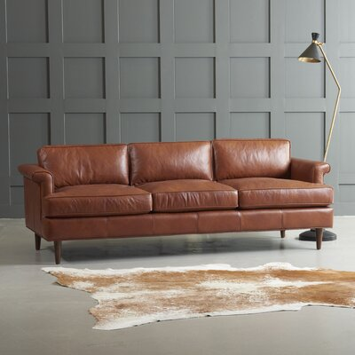 Carson Leather Sofa Body Fabric: Steamboat Driftwood, Leg Finish: French Oak