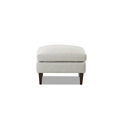 Florence Ottoman Leg Finish: Black Walnut, Body Fabric: Eyespot Storm