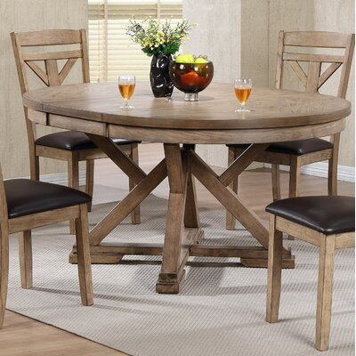 Carnspindle Round Butterfly Leaf Dining Table