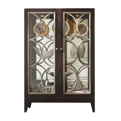 Cosmopolitan Lighted Curio Cabinet with Glass Doors Color: Connoisseur - Muslin, Accents: Silver