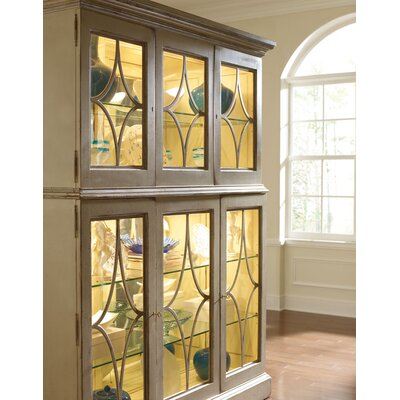 Sutton Lighted Curio Cabinet Color: Connoisseur - Muslin, Accent Color: Champagne