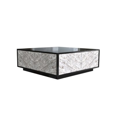 Oslo Abstract Serrated Coffee Table Color: Connoisseur/Tricorn Black, Accent Color: Champagne