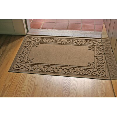 Aqua Shield Iron Fleur Doormat Color: Camel