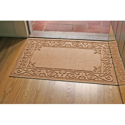 Aqua Shield Iron Fleur Doormat Color: Medium Brown