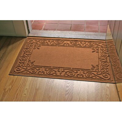 Aqua Shield Iron Fleur Doormat Color: Dark Brown