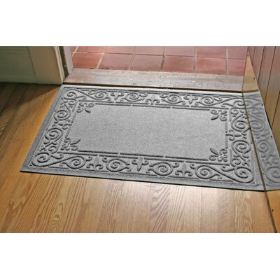 Aqua Shield Iron Fleur Doormat Color: Medium Gray