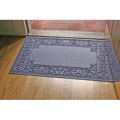 Aqua Shield Iron Fleur Doormat Color: Bluestone