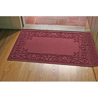 Aqua Shield Iron Fleur Doormat Color: Bordeaux