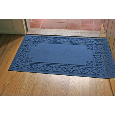 Aqua Shield Iron Fleur Doormat Color: Navy