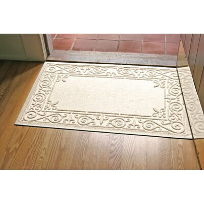 Aqua Shield Iron Fleur Doormat Color: White