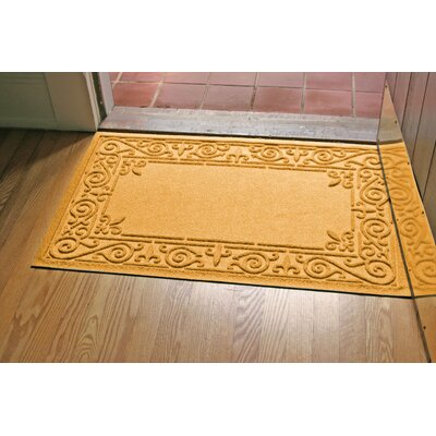 Aqua Shield Iron Fleur Doormat Color: Yellow