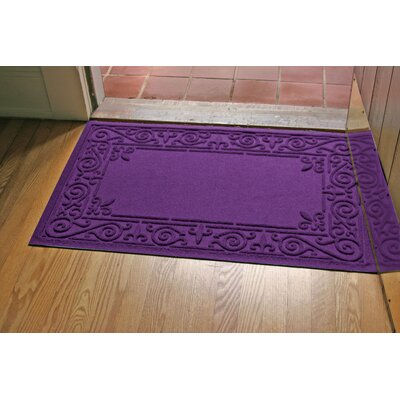 Aqua Shield Iron Fleur Doormat Color: Purple