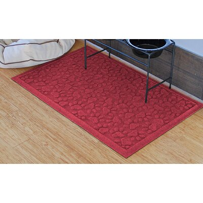 Aqua Shield Scattered Dog Paws Doormat Color: Red