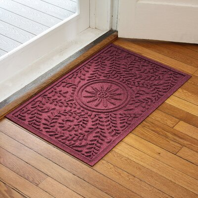 Aqua Shield Boxwood Flower Doormat Color: Bordeaux