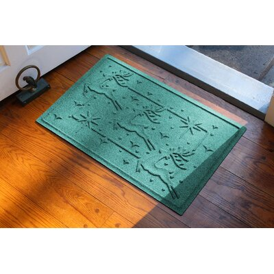 Aqua Shield Reindeer Row Doormat Color: Aquamarine