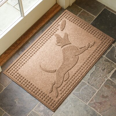 Amald Flying Dog Doormat Color: Medium Brown